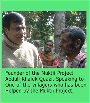 Founder of the Muktii Project  Abdull Khalek Quazi. Speaking to  One of the villagers who has been Helped by the Muktii Project.
